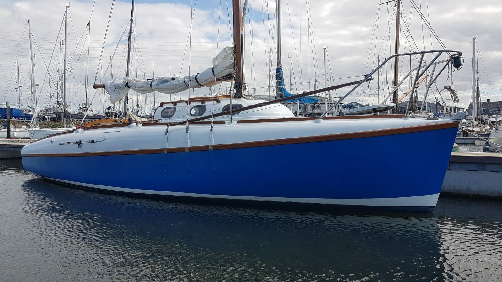 The hull and decks are in good, but not perfect, condition - starboard side