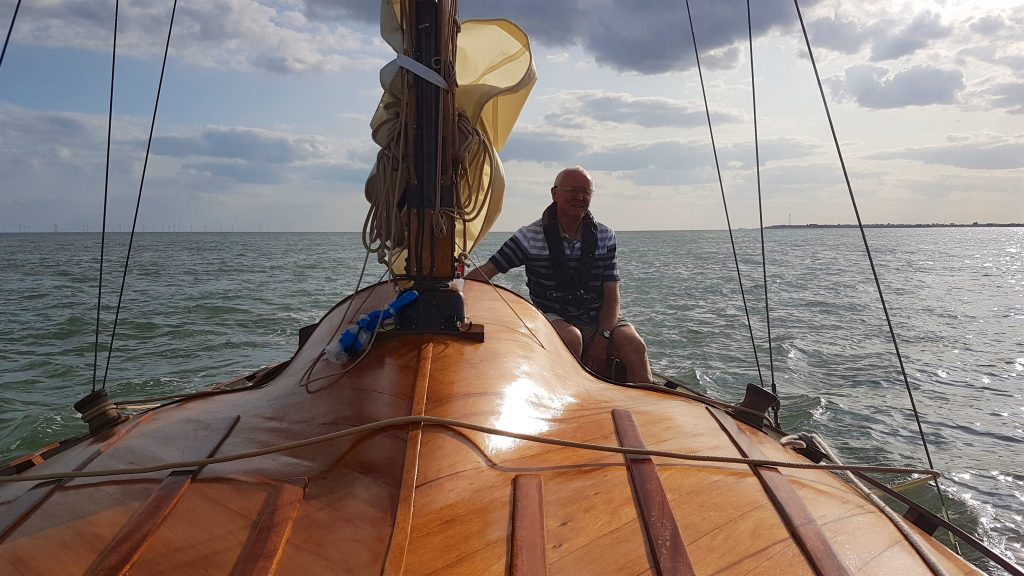 The happy Skipper at the helm. Not enough wind for sailing sadly.