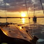 Motoring up the River Orwell as the sun sets.