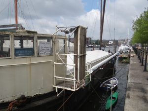 Noble Masts - an historic name in hollow mast making - operate from two barges