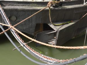 Slightly modified barges. Mast rack welded to the gunwale in the previous photo and here is a hatch in the stern to allow long spars to be passed in and out