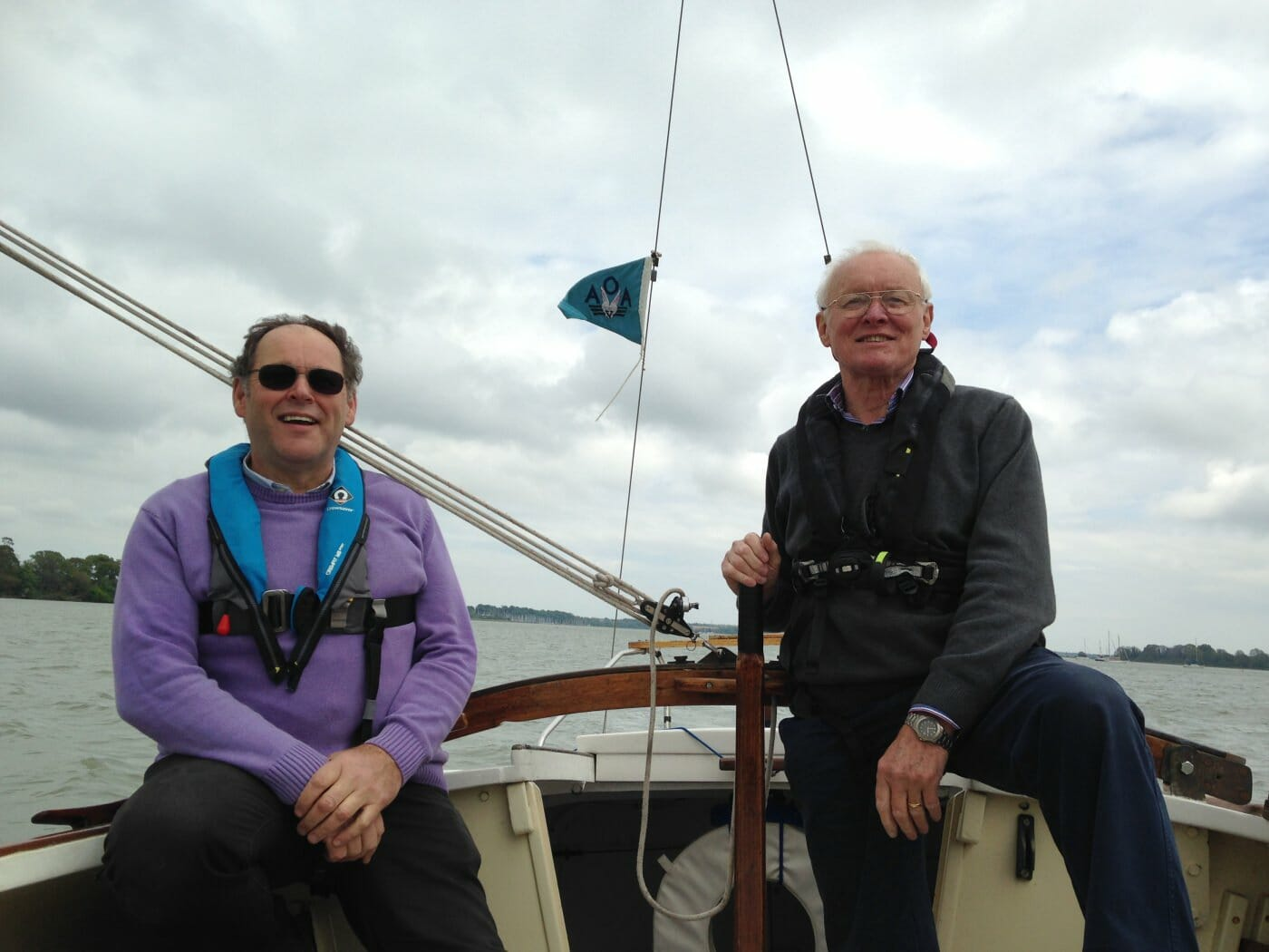 AOA Commodore Mike Dixon helming A89 Colchide on the River Orwell in May 2017 with Webmaster and Treasurer Nick Phillips crewing