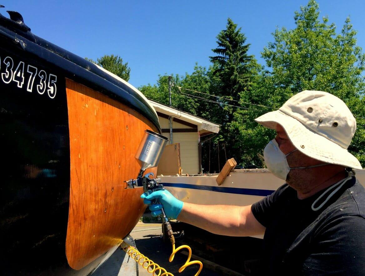 Michel spraying varnish on A33