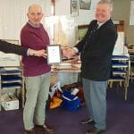 Atalanta Trophy - RIchard James, A89 Colchide, receives the wooden model of A12 for winning the East Coast Race.