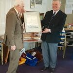 Sinclair Tophy - Colin Tywford, ex Commodore, Secretary and owner of A95 Hiran, receives the painting of A71 for services to the AOA.