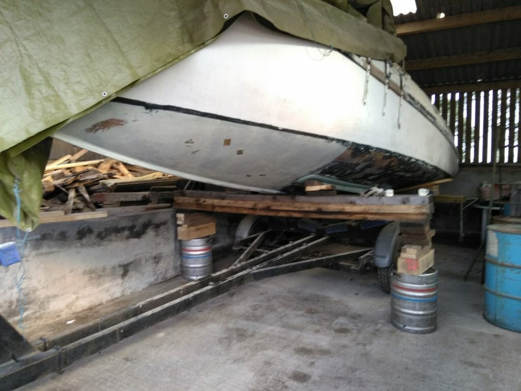 The precarious bit - high enough to get the trailer out without touching the barrels or beams!