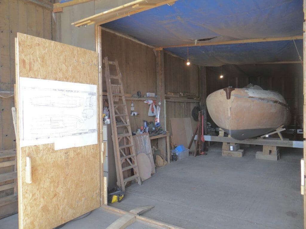 View of the workshop with the plans on the door.