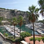 The small yacht harbour with Old Monace on the cliff top