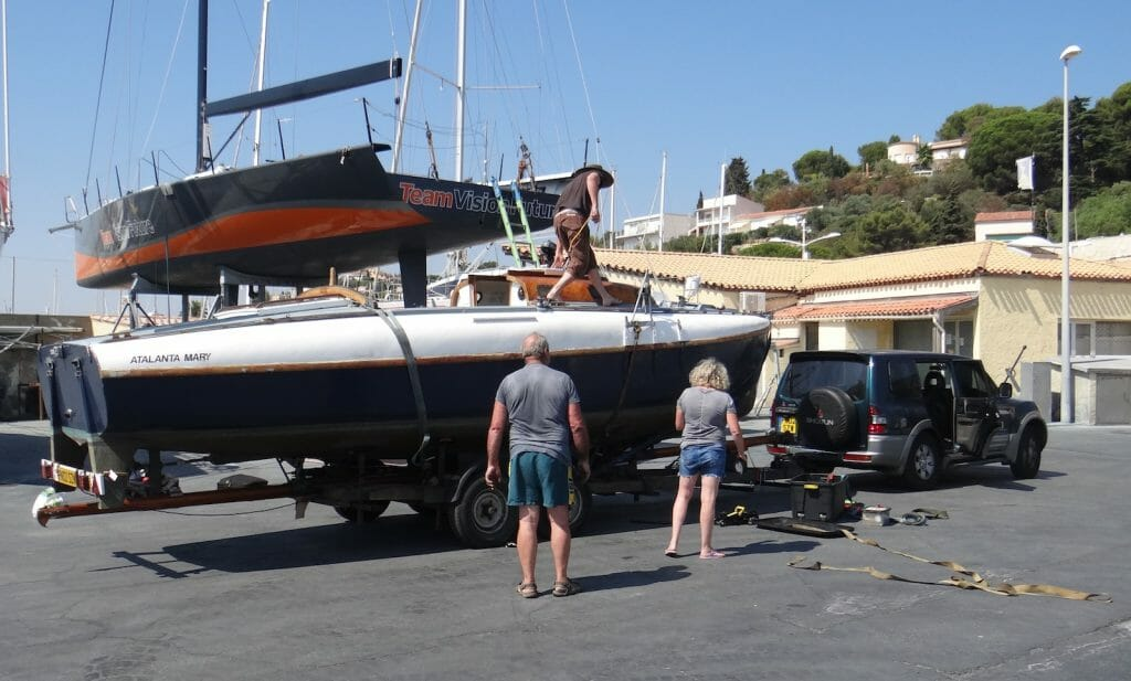 Loaded on the trailer mast threaded under the hull. Ready to go home.