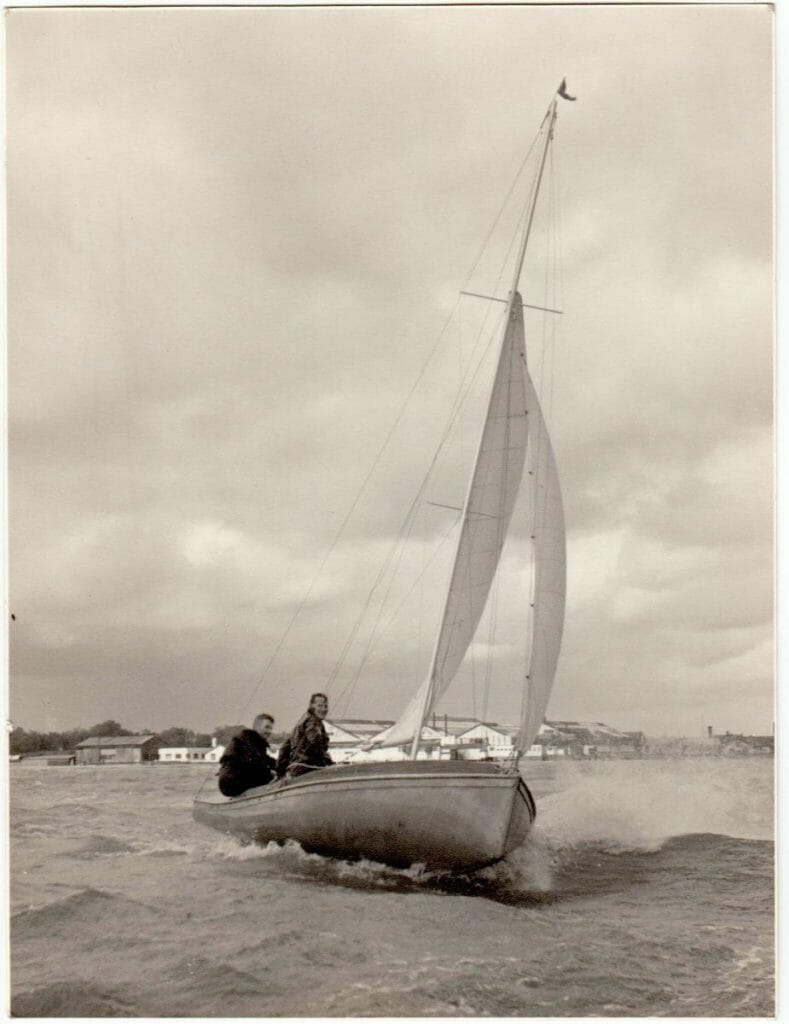 Sujanwiz helmed by Alan Vines sailing on the Hamble with his brother in law Jimmy Mumford crewing. Fairey Marine factory in the background.