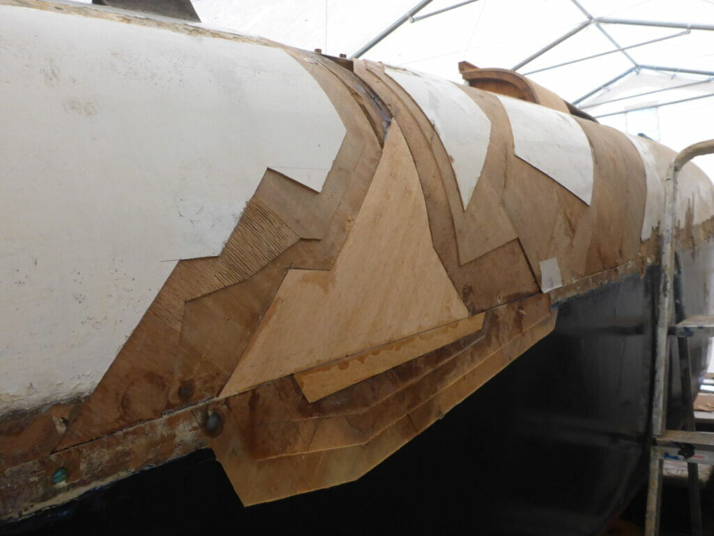 The first laminate layer back on the deck and hull.